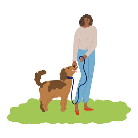 Woman walking her dog on leash and training commands outdoor
