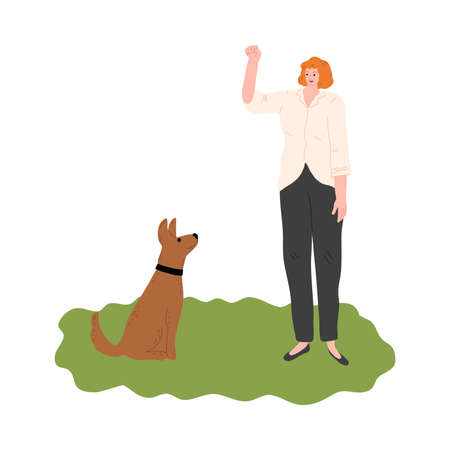 Woman training her dog with showing gesture by hand outdoor during walk Vettoriali