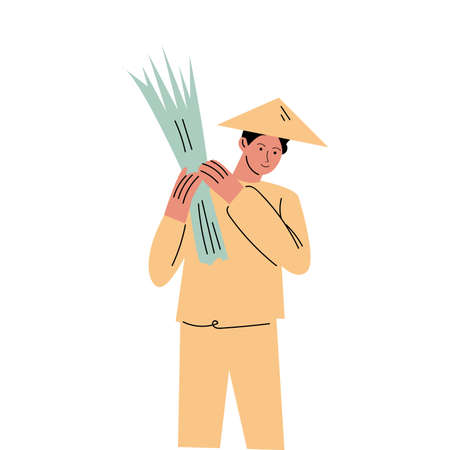 Asian man farmer in special costume and hat holding freshly picked rice