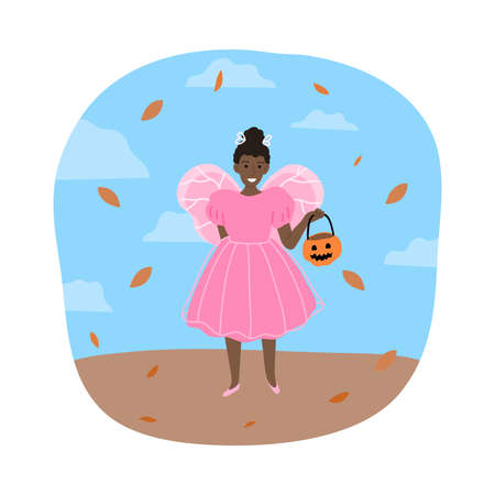 Girl in fairy costume for Halloween holiday standing and holding pumpkin