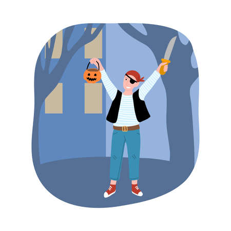Boy in pirates costume for Halloween standing and holding pumpkin and knife in hands