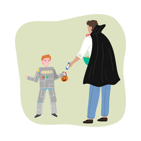Man in costume giving sweets to smiling boy in robot costume for Halloween