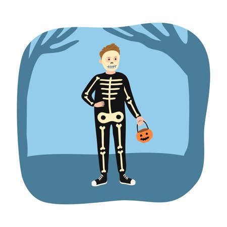 Boy in skeleton costume and mask for Halloween holiday standing and holding pumpkin in hand