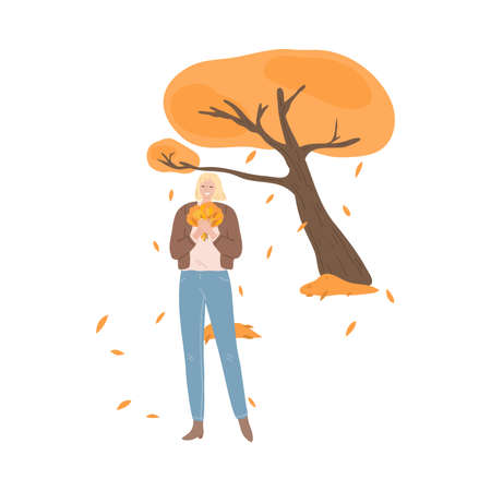 Happy young girl standing with heap of golden leaves in autumn park Stock Illustratie