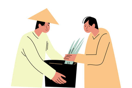 Two asian men farmers in special costumes picking rice and putting in basket