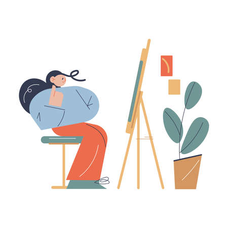 Woman sitting opposite easel with artwork and thinking about details in art studio Ilustração