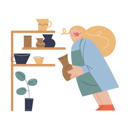 Woman carrying handmade jug from clay to shelf in pottery studio