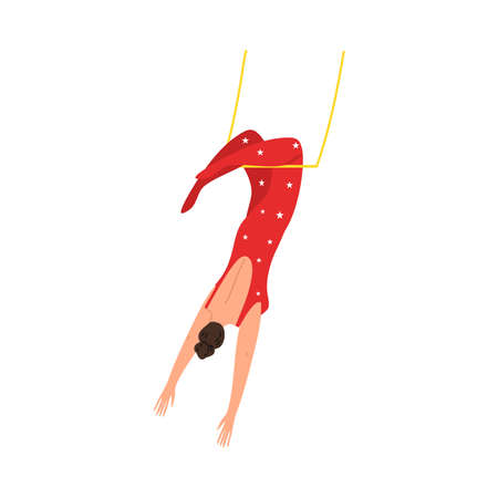 Girl aerialist in red costume hanging in air during performance in circus
