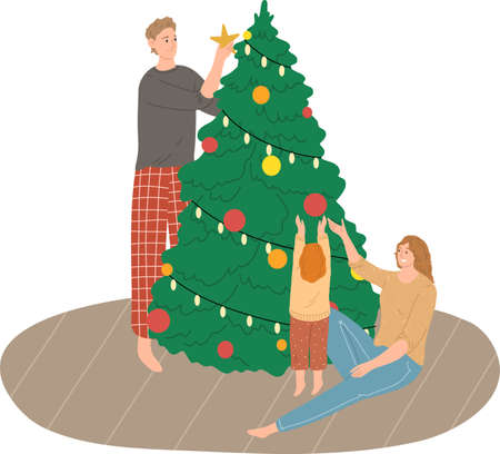 Happy family with small daughter decorating Christmas tree at home together