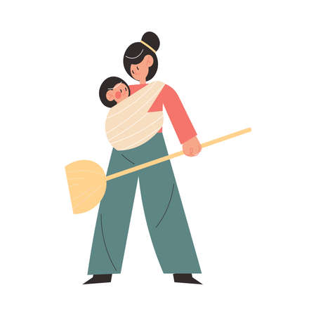 Smiling active young mother doing housework with small baby sitting in sling