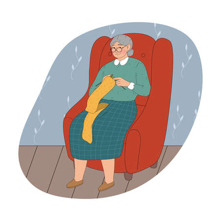 Grandmother in glasses sitting in armchair at home and knitting yellow scarf