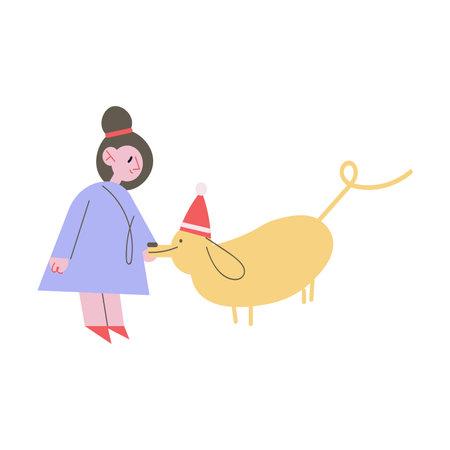 Happy small girl walking dog in festive Christmas cap