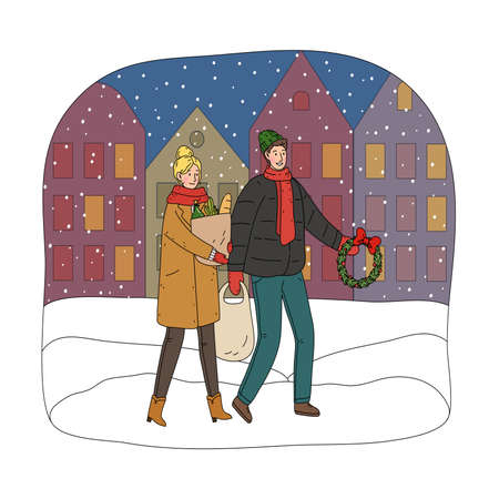 Young happy couple carrying shopping bags with food and decorations