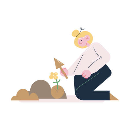 Woman gardener sitting on knees and taking care of soil for putting seedlings