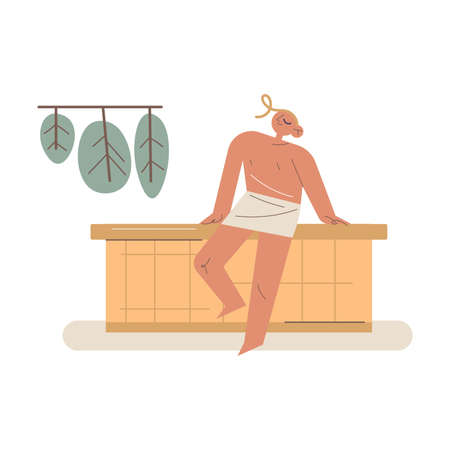 Smiling young man in towel sitting in sauna enjoying heat relaxation