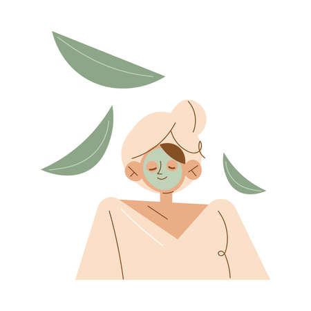 Smiling young caucasian woman enjoying green organic face mask in spa