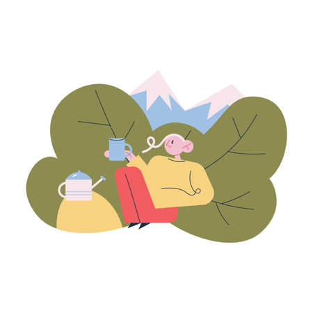 Tourist sitting relaxing enjoying cup of hot tea or coffee during traveling in mountains
