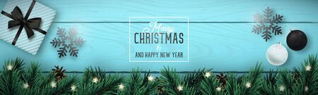 Christmas composition on blue wooden background. Realistic vector christmas tree branches, light garland, pine cone, decorative bauble, gift box and snowflake. Long greeting banner. Иллюстрация