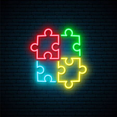 Puzzle neon sign. Bright Autism symbol on dark brick wall background. World Autism Day neon signboard. Vector illustration.