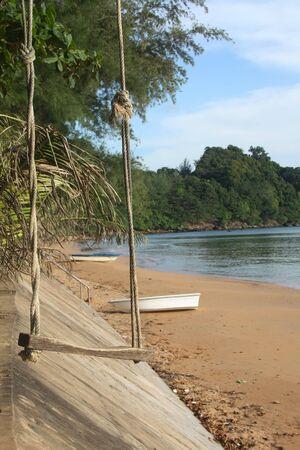 Swing on sea beach photo