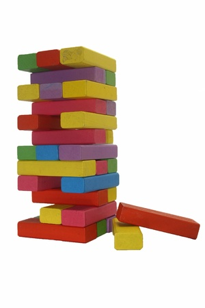 kiddy: colorful wooden toy blocks tower isolated on white background