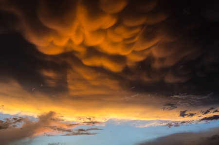 Orange mammatus clouds on black sky before a powerful hurricane