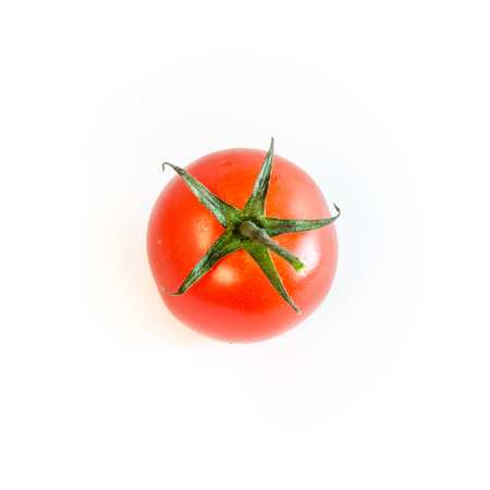 One single cherry tomato with stem isolated on white background, top view