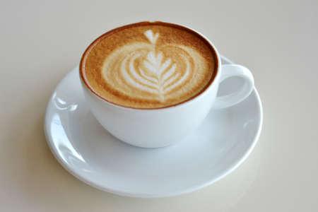 cappuccio: Cup of art latte on a cappuccino coffee
