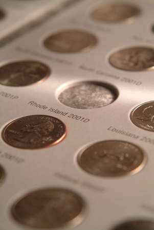 U S state quarters coin collection in book