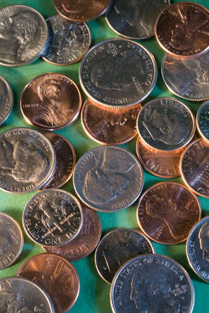 transact: a pattern of coins spread out on a flat surface