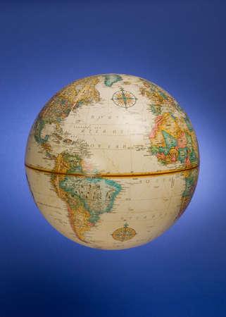 a globe against a blue background Banco de Imagens