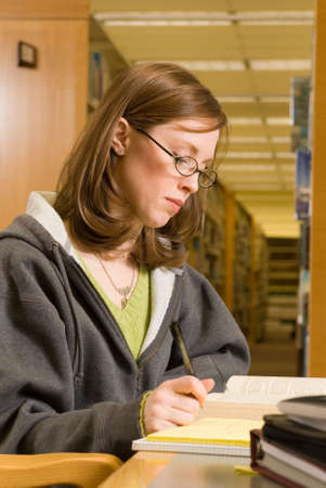 a young woman studies in the library Stock Photo - 2758832
