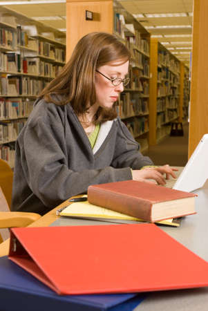 a young woman studies in the library Stock Photo - 2758830