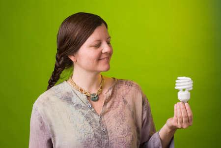 environmentalist: an environmentalist holds a compact fluorescent light bulb