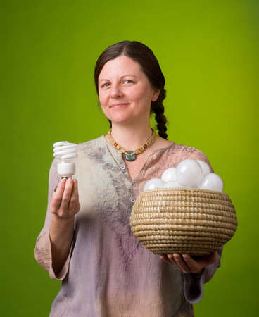 environmentalist: an environmentalist comparing one compact fluorescent light bulb to many incandescent light bulbs Stock Photo