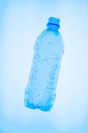 an empty clear plastic water bottle