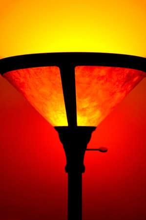floor lamp: turning on a floor lamp Stock Photo