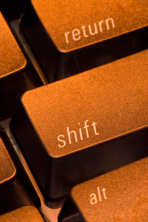 compute: the shift key on a computer keyboard