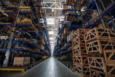wares: Large storehouse with tall racks full of various wares