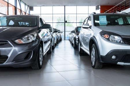 Stock of cars in showroom of automobile dealer Standard-Bild