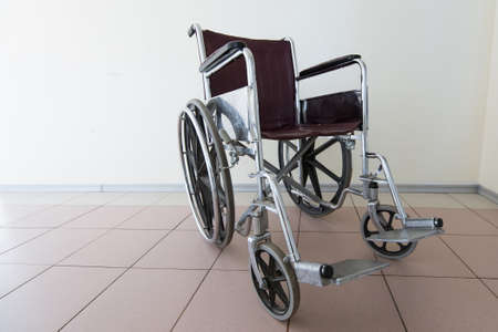 invalidity: Empty wheelchair stands in patient rooms at hospital.