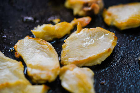 serving utensil: Close up photography of roasted meat slices on skillet