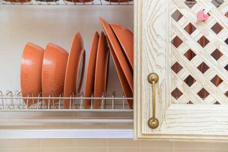 Beautiful clean dishes in rustic kitchen cupboard