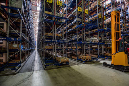 storehouse: Large storehouse with tall racks full of various wares