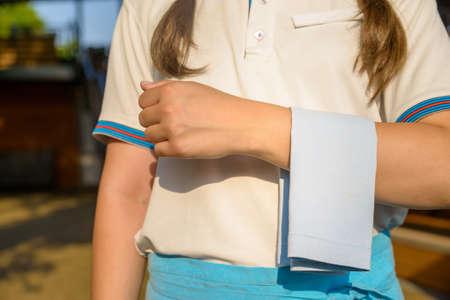 Cropped image of waitress carrying white napkin Stock Photo