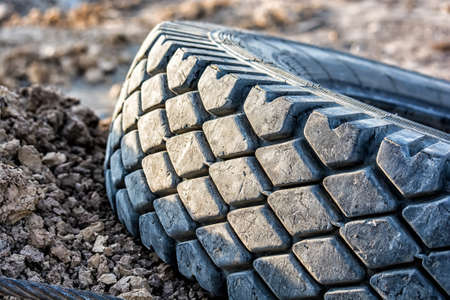 Disposal used car tire lies on the ground