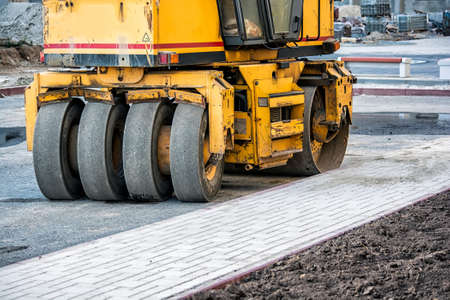 construction vibroroller: Pneumatic tyred roller compactor at asphalt road repairing