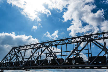viaducts: Steel railroad bridge over the river on sky background Stock Photo