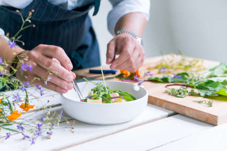 Closeup image of chef cooks delicious meal at luxurious restaurant Stock Photo
