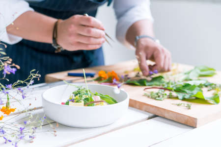 Closeup image of chef cooks delicious meal at luxurious restaurant Фото со стока